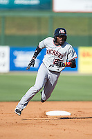 Travis Demeritte (25) of the Hickory Crawdads flies around second base on his way to a stand-up triple against the Kannapolis Intimidators at CMC-Northeast Stadium on May 21, 2015 in Kannapolis, North Carolina.  The Intimidators defeated the Crawdads 2-0 in game one of a double-header.  (Brian Westerholt/Four Seam Images)
