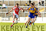Tadhg Morley Kenmare in action against George O'Keeffe Rathmore in the Senior County Football Semi Final in Fitzgerald Stadium on Sunday.