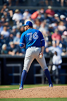 Toronto Blue Jays relief pitcher Conor Fisk (76) looks in for the sign during a Grapefruit League Spring Training game against the New York Yankees on February 25, 2019 at George M. Steinbrenner Field in Tampa, Florida.  Yankees defeated the Blue Jays 3-0.  (Mike Janes/Four Seam Images)