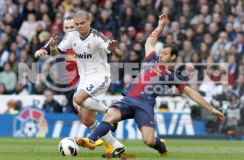 Real Madrid's Pepe (c) and FC Barcelona's Andres Iniesta (l) and Javier Mascherano during La Liga match.March 02,2013. (ALTERPHOTOS/Acero) /NortePhoto