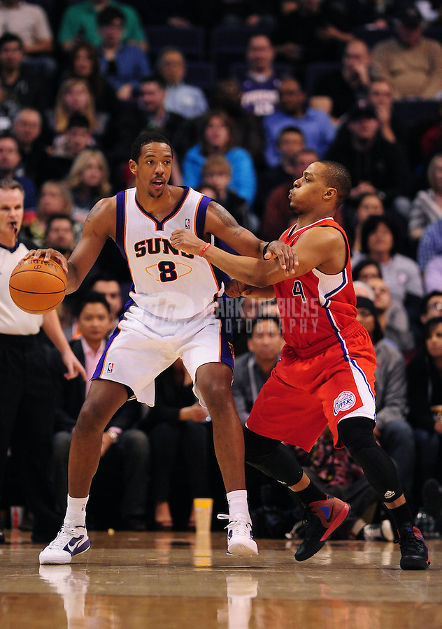 Mar. 2, 2012; Phoenix, AZ, USA; Phoenix Suns center Channing Frye (8) controls the ball against Los Angeles Clippers guard Randy Foye (4) at the US Airways Center. The Suns defeated the Clippers 81-78. Mandatory Credit: Mark J. Rebilas-USA TODAY Sports