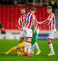 12th February 2020; Bet365 Stadium, Stoke, Staffordshire, England; English Championship Football, Stoke City versus Preston North End; James McClean of Stoke City pushes Ben Pearson of Preston North End to the floor