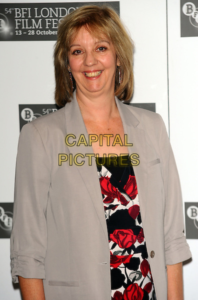 RUTH SHEEN .attending the 'Another Year' photocall during the 54th BFI London Film Festival at the Vue West End, Leicester Square, London, England, UK, .October 18th 2010.. LFF half length black print white red dress grey gray jacket blazer smiling .CAP/CJ.©Chris Joseph/Capital Pictures.