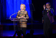 September 30, 2013  (Washington, DC)  Former Secretary of State Hillary Rodham Clinton speaks at the Children's Defense Fund 40th anniversary celebration at the Kennedy Center's Concert Hall as Marian Wright Edelman looks on.  (Photo by Don Baxter/Media Images International)