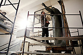 Cracow, Poland March 1, 2011:.Rafal Cywinski, artist at Czeslaw Dzwigaj sculptor workshop, working on a  monument of pope John Paul 2. Dzwigaj has made over 70 sculptures of the late pope.. (Photo by Piotr Malecki / Napo Images)..Krakow, 1/03/2011:.Rafal Cywinski podczas pracyw  w pracowni profesora Czeslawa Dzwigaja.  Powstaly tu juz 72 pomniki papieza Jana Pawla II.Fot: Piotr Malecki / Napo Images