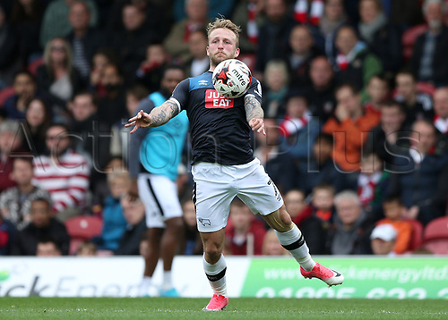 April 14th 2017,  Brent, London, England; Skybet Championship football, Brentford versus Derby County; Johnny Russell of Derby County controls the high ball
