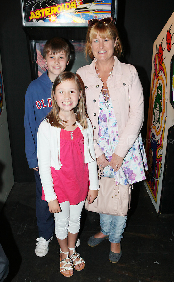 NO REPRO FEE. 20/9/2010. Game On Exhibition.  Fiona Looney with Liam 11 and Uainin 8 are pictured at the opening of the Game On Exhibition at Dublin's Ambassador Theatre. Game On is an action packed gaming exhibition with fun for all the family. Enjoy a totally interactive experience with rare memorabilia and play your way through over 120 playable games from the arcade classics to the latest releases. Now running at the Ambassador Theatre for a limited run. Tickets from 10 euro including booking fee on sale now See Ticketmaster.ie and Gameon-Dublin.ie for family and group discounts plus more details. Picture James Horan/Collins Photos