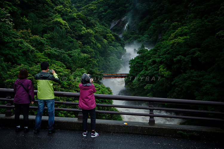 Yakushima, June 2011 - Tourists taking a picture of Segire no taki (waterfall) after heavy rains. A local proverb says that it rains 35 days a month in Yakushima.