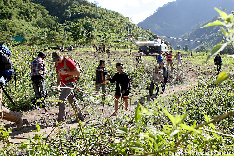 Capt. David Garcia and local villagers hike to a JPAC dig site near Ta Oy, Laos on Wednesday, November 7, 2012. (Star-Telegram/Khampha Bouaphanh)