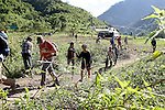 Capt. David Garcia and local villagers hike to a JPAC dig site near Ta Oy, Laos on Wednesday, November 7, 2012. (Star-Telegram/Khampha Bouaphanh)