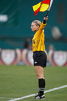An assistant referee indicates possession for a throw-in. The women's national team of the United States defeated Canada 6-0 during an international friendly at Robert F. Kennedy Memorial Stadium in Washington, D. C., on May 10, 2008.