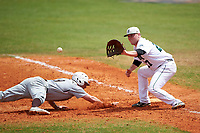 Dartmouth Big Green first baseman Michael Ketchmark (27) stretches for a pickoff attempt throw as Jacen Nalesnik (19) dives back to the bag during a game against the Lehigh Mountain Hawks on March 20, 2016 at Chain of Lakes Stadium in Winter Haven, Florida.  Dartmouth defeated Lehigh 5-4.  (Mike Janes/Four Seam Images)