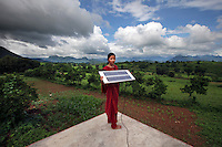 20 year old Meenakshi Dewan is one of four women from the village of Tinginapu who has been trained in solar powered engineering by The Orissa Tribal Empowerment and Livelihoods Programme (OTELP), an organisation funded by DFID (Department for International Development) and run with the state government of Orissa. The Orissa Tribal Women's Barefoot Solar Engineers Association has now got a contract to build 3,000 solar-powered lanterns for schools and other institutions and is training other people in the community.