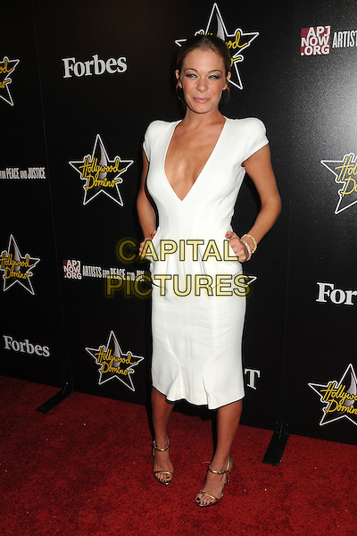 LeAnn Rimes  .5th Annual Hollywood Domino Gala & Tournament held at the Sunset Tower Hotel, West Hollywood, California, USA..February 23rd, 2012.full length white dress plunging neckline cleavage hands on hips peplum.CAP/ADM/BP.©Byron Purvis/AdMedia/Capital Pictures.