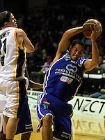 Troy McLean steals a rebound from Ben Jeffery during the NBL Basketball match between Wellington Saints and Devon Dynamos Taranaki at TSB Bank Arena, Wellington, New Zealand on Friday, 11 April 2008. Photo: Dave Lintott / lintottphoto.co.nz