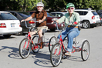 NWA Democrat-Gazette/DAVID GOTTSCHALK  Ray Kannard , 86,(left) and Norma Tomboulian, 84, ride a pair of tricycles Tuesday, September 15, 2015 on the trail on the perimeter of Murphy Park in Springdale. The two ride three to four times a week taking on the different trails on the area including the Razorback Greenway trail.