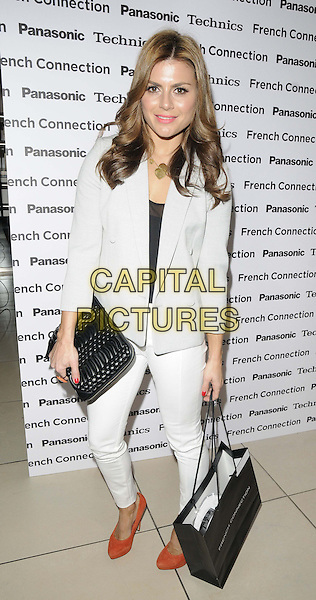 Zoe Hardman.attended the Panasonic & French Connection : Shop to the Beat launch party, French Connection, Oxford St.,  London, England..March 13th, 2013.full length white grey gray blazer black clutch bag jeans denim red orange shoes shopping.CAP/CAN.©Can Nguyen/Capital Pictures.