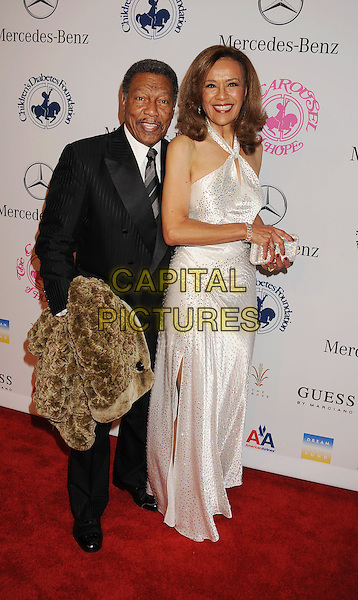 Billy Davis, Marilyn McCoo.The 26th Anniversary Carousel Of Hope Ball presented by Mercedes-Benz at The Beverly Hilton Hotel in Beverly Hills, California, USA..October 20th, 2012.full length black suit white dress.CAP/ROT/TM.©Tony Michaels/Roth Stock/Capital Pictures