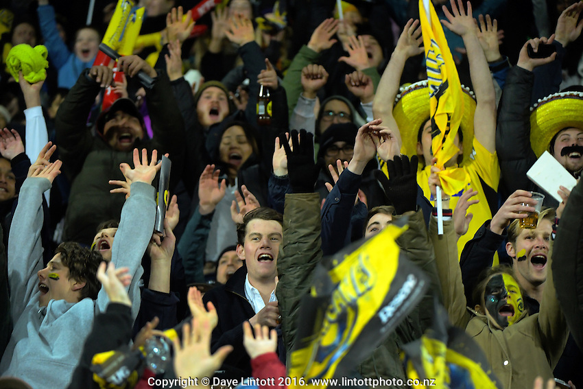 Fans perform a Mexican Wave during the Super Rugby semifinal match between the Hurricanes and Chiefs at Westpac Stadium, Wellington, New Zealand on Saturday, 30 July 2016. Photo: Dave Lintott / lintottphoto.co.nz