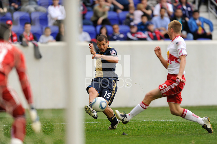 Alejandro Moreno (15) of the Philadelphia Union crosses the ball past Tim Ream (5) of the New York Red Bulls  for an assist on the Philadelphia Union's goal. The New York Red Bulls defeated the Philadelphia Union 2-1 during a Major League Soccer (MLS) match at Red Bull Arena in Harrison, NJ, on April 24, 2010.
