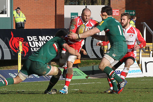 16.02.2014 Leicester, England. Gloucesters Charlie Sharples makes a break during the Aviva Premiership game between Leicester Tigers and Gloucester Rugby from Welford Road Stadium.