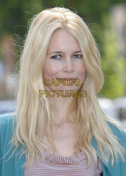 "CLAUDIA SCHIFFER .Poses at a photocall for the Global Call To Action Against Poverty (GCAP), in front of images of the G8 Finance Ministers to say ""we'll be watching you"",.Westminster, London, June 9th 2005..portrait headshot.Ref: PL.www.capitalpictures.com.sales@capitalpictures.com.©Capital Pictures"