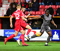 Lincoln City's John Akinde vies for possession with Swindon Town's Canice Carroll, left, and Luke Woolfenden<br /> <br /> Photographer Andrew Vaughan/CameraSport<br /> <br /> The EFL Sky Bet League Two - Swindon Town v Lincoln City - Saturday 12th January 2019 - County Ground - Swindon<br /> <br /> World Copyright © 2019 CameraSport. All rights reserved. 43 Linden Ave. Countesthorpe. Leicester. England. LE8 5PG - Tel: +44 (0) 116 277 4147 - admin@camerasport.com - www.camerasport.com