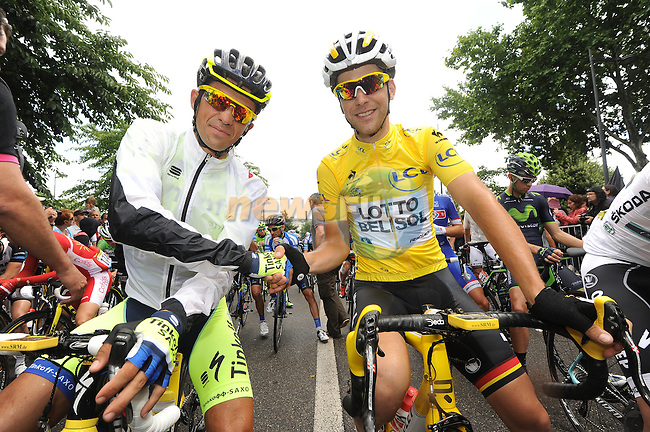 Alberto Contador (ESP) Tinkoff-Saxo wishes Yellow Jersey leader Tony Gallopin (FRA) Lotto-Belisol good luck on Bastille Day before the start of Stage 10 of the 2014 Tour de France running 161.5km from Mulhouse to La Planche des Bellles Filles. 14th July 2014.<br /> Photo ASO/B.Bade/www.newsfile.ie