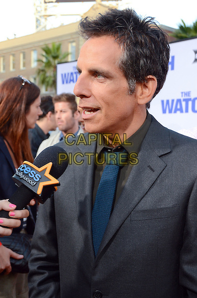 Ben Stiller.The L.A. Premiere of 'The Watch' held at The Grauman's Chinese Theatre in Hollywood, California, USA..July 23rd, 2012.half length grey gray suit black shirt blue tie  interview microphone mouth open profile .CAP/ADM/BT.©Birdie Thompson/AdMedia/Capital Pictures.