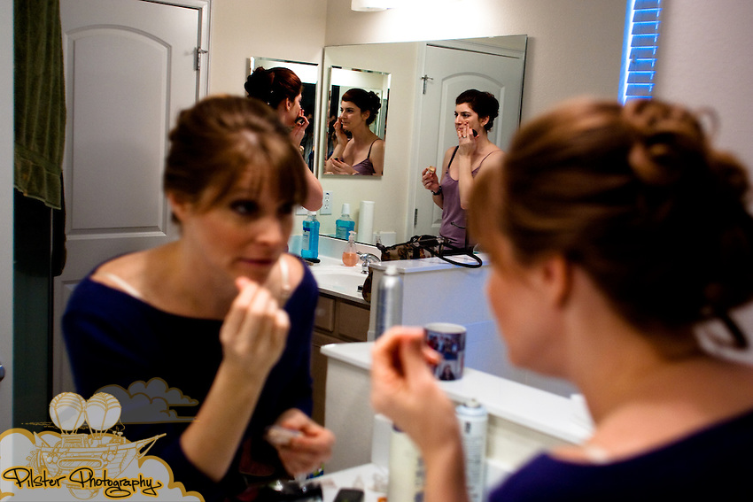 Before the wedding of Shelby Wheeler and John Mack on Saturday November 7, 2009 at their home in Winter park. She started at Essence Salon & Day Spa then had the ceremony took place at Sts. Peter & Paul Catholic Church in Winter Park and then moved to the reception at the Historic Dubsdread Ballroom in College Park in Orlando. (Chad Pilster, http://www.PilsterPhotography.net)