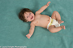 4 month old baby boy portrait in back in diaper, laughing