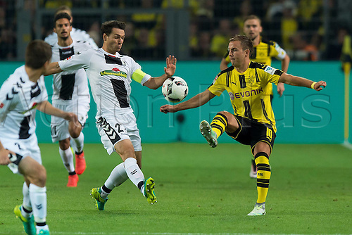 23.09.2016. Dortmund, Germany. German Bundesliga Football. Borussia Dortmund versus SC Freibrug.  Nicolas Hoefler (SCF) challanges Mario Goetze (BVB)