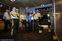 LE MANS, FRANCE: The Corvette Racing crew monitors watches the television monitor in the pit box during practice for the 24 Hours of Le Mans on June 16, 2002, at Circuit de la Sarthe in Le Mans, France.