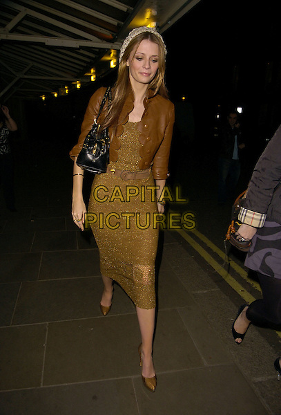 MISCHA BARTON.At The  Noel Gallager Teenage Cancer Trust Charity Concert held at the Royal Albert Hall, London, England,.March 26th 2007..full length brown cropped leather jacket gold dress shoes hat black bag waist belt.CAP/CAN.©Can Nguyen/Capital Pictures
