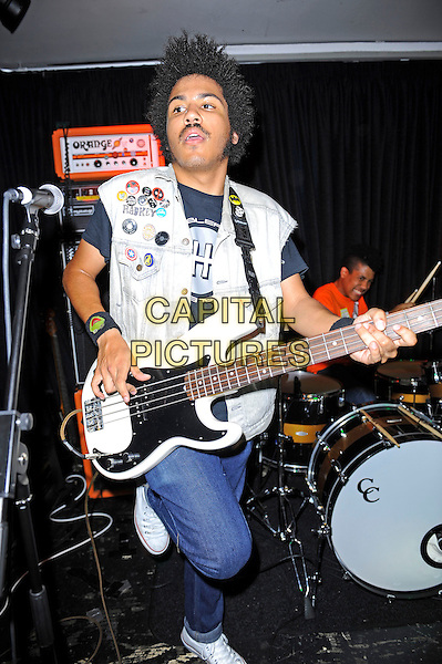 Isaiah Radke and Solomon Radke of Radkey <br /> performing in concert, The Blackeart, Camden, London, England. <br /> 17th October 2013<br /> on stage in concert live gig performance performing music full length white jean denim jacket sleeveless bass guitar orange top drums <br /> CAP/MAR<br /> &copy; Martin Harris/Capital Pictures