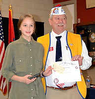 Janelle Jessen/Herald-Leader<br /> Frank Lee, commander of Veterans of Foreign Wars Post 1674, right, presented Addison Huebert with the first place award an $100 prize for the Patriots Pen essay contest on Feb. 12.
