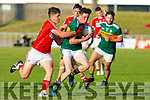 Mark Ryan of Kerry keeps possession as Cork's Colm O'Callaghan puts in a tackle during the Munster U20 Football final in Austin Stack Park on Friday.