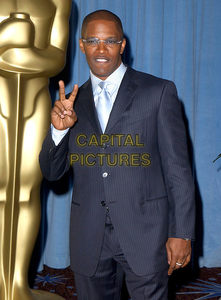 JAMIE FOXX.Attends The 77th Annual Academy Awards Nominees Luncheon held at The Beverly Hilton Hotel,.Beverly Hills, California, USA, .February 7th 2005..half length fingers peace sign gesture glasses lunch.Ref: DVS.www.capitalpictures.com.sales@capitalpictures.com.©Capital Pictures.