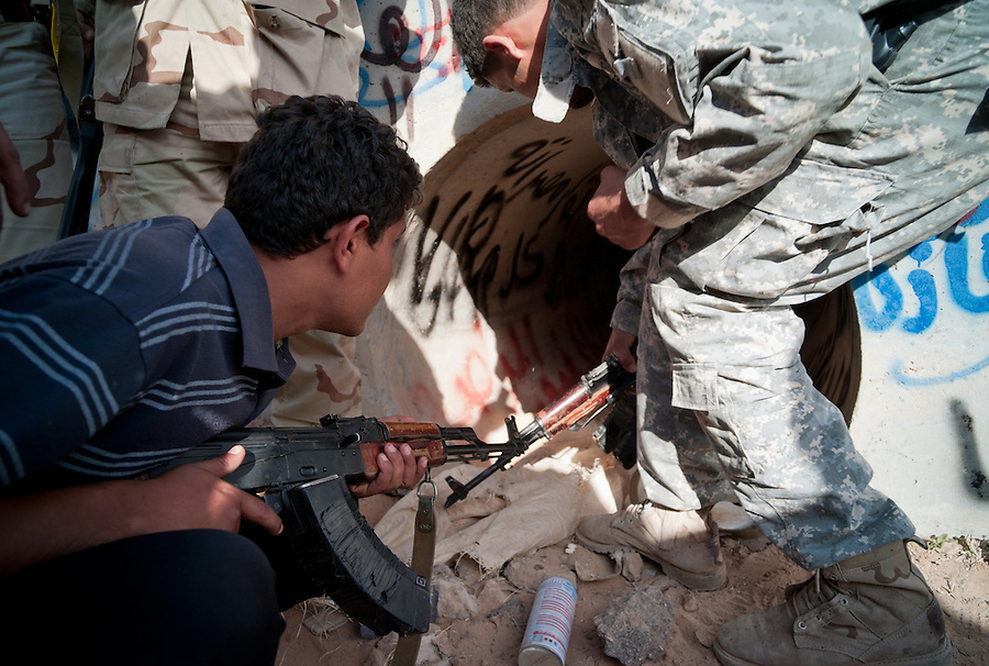 Anti-Gaddafi fighters inspect the tunnel where Muammar Gaddafi is claimed to have been found in Sirte, Libya, October 20, 2011. The death of Muammar Gaddafi brings closure to an 8 month uprising turned revolutionary war.