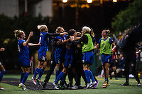 Seattle, Washington -  Sunday, September 11 2016: Seattle Reign FC midfielder Keelin Winters (11) celebrates her goal with ther teammates during a regular season National Women's Soccer League (NWSL) match between the Seattle Reign FC and the Washington Spirit at Memorial Stadium. Seattle won 2-0.