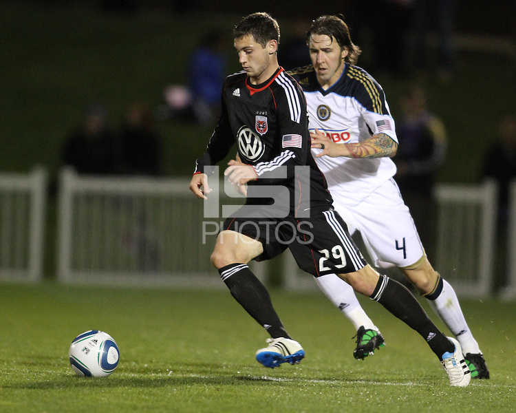 Blake Brettechneider(29) of D.C. United pushes away from Danny Califf(4) of the Philadelphia Union during a play-in game for the US Open Cup tournament at Maryland Sportsplex, in Boyds, Maryland on April 6 2011. D.C. United won 3-2 after overtime penalty kicks.