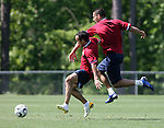 Landon Donovan (center) shields Clint Dempsey (r) from the ball during a drill on Tuesday, May 16th, 2006 at SAS Soccer Park in Cary, North Carolina. The United States Men's National Soccer Team held a training session as part of their preparations for the upcoming 2006 FIFA World Cup Finals being held in Germany.