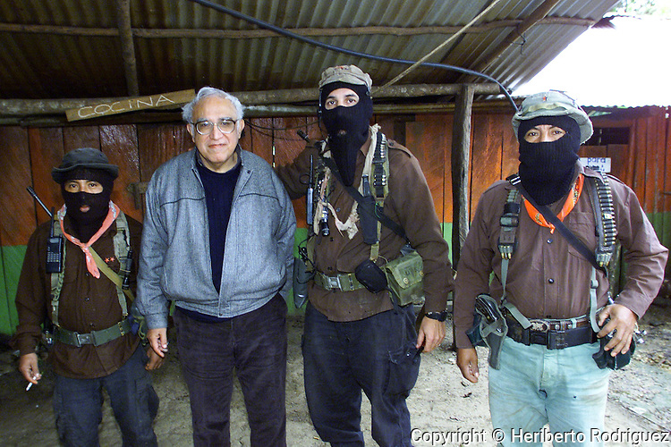 File picture of Mexican writer Carlos Monsivais and Subcomandante Marcos, Mayor Moises and Comandante Tacho  in La Realidad village in southern state of Chiapas, December 2000. Monsivais died today at age 72. Photo by Heriberto Rodriguez