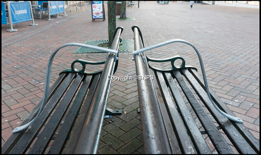 BNPS.co.uk (01202 558833)Pic: LeeMcLean/BNPS<br /> <br /> Bournemouth Council's latest deterrent for homeless sleepers.<br /> <br /> A tourist resort's latest ploy to rid the town of homeless people by installing anti-rough sleeper bars on park benches has been branded 'shameful'.<br /> <br /> Numerous public benches in Bournemouth, Dorset, have been fitted with curved steel bars down the middle of them to make it physically  impossible for people to lay down.<br /> <br /> The result leaves the bench split in two with the users only be able to sit upright.<br /> <br /> Outraged locals said the bars were a 'design against humanity' and accused the town hall officials of taking an aggressive and hostile stance against vulnerable rough sleepers.