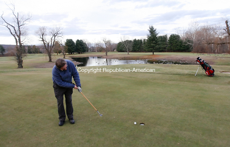 SOUTHBURY, CT 12/02/08- 120208BZ02- Ken Liljeback (CQ), of Southbury, makes a putt on the fourth hole of a deserted Heritage Village Country Club Golf Course Tuesday afternoon.  Liljeback said he's been amember of the club for 24 years.<br /> Jamison C. Bazinet Republican-American
