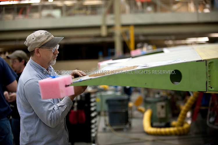 4/30/2009--Everett, WA, USA..Wings being built for the new Boeing 747-8 under construction at Boeing's Everett, WASH. factory. The 747-8 is a widebody commercial airliner being developed by Boeing Commercial Airplanes. Officially announced in 2005, the 747-8 is the latest evolutionary variant of the Boeing 747, with lengthened fuselage, redesigned wings and improved efficiency. With a maximum take-off weight of 975,000 lb (442,000 kg), the 747-8 will be the heaviest aircraft, commercial or military, to be manufactured in the United States...©2009 Stuart Isett. All rights reserved.