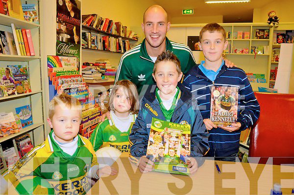 FANS: Michael, Leanne & Timmy Flaherty (Moyvane) with Tadhg McEllistrim (Ballylongford) who got Tadhg Kennelly to sign a copy of his book, Unfinished Business, at Woulfe's Bookshop in Listowel last Tuesday.