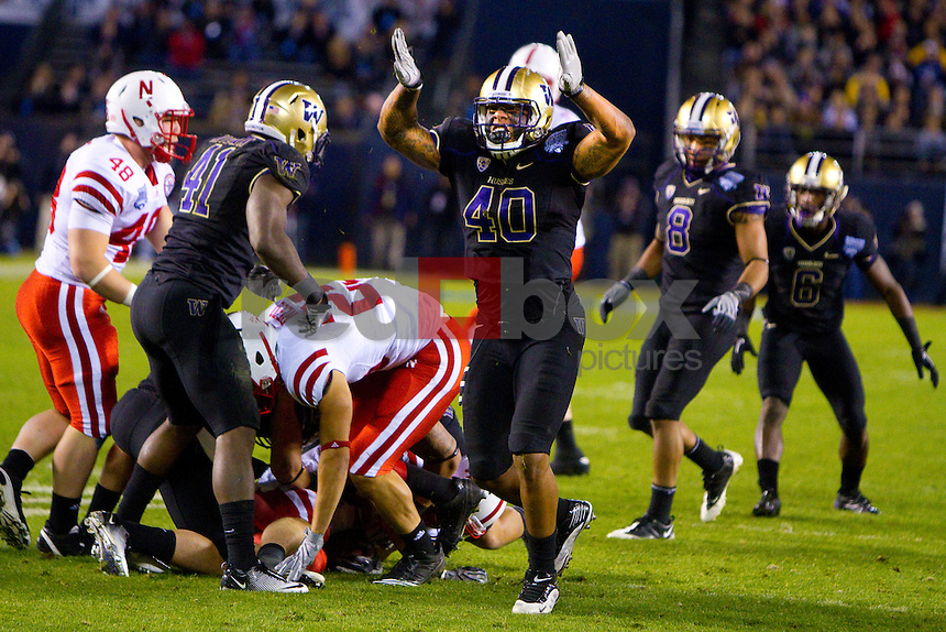 Victor Aiyewa, Mason Foster, Nate Williams,  Desmond Trufant. The UW defeats Nebraska in the 2010 Bridgepoint Education Holiday Bowl 19-7 at Qualcomm Stadium in San Diego. (Photography By Scott Eklund/Red Box Pictures)