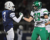 Farmingdale No. 27 Steve Kunz, right, shakes hands with Oceanside No. 3 Ryan Penna after the Nassau County varsity football Conference I final at Hofstra University on Saturday, Nov. 21, 2015. Farmingdale won by a score of 34-23.<br /> <br /> James Escher