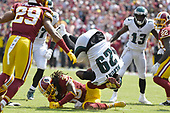 Philadelphia Eagles running back LeGarrette Blount (29) is tripped-up by Washington Redskins defensive back Joshua Holsey (38) in first quarter action at FedEx Field in Landover, Maryland on Sunday, September 10, 2017.  The Eagles won the game 30 -17.<br /> Credit: Ron Sachs / CNP